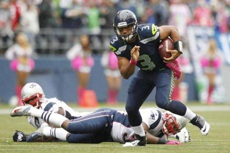 Seattle Seahawks quarterback Russell Wilson scrambled against the New England Patriots in the first half.